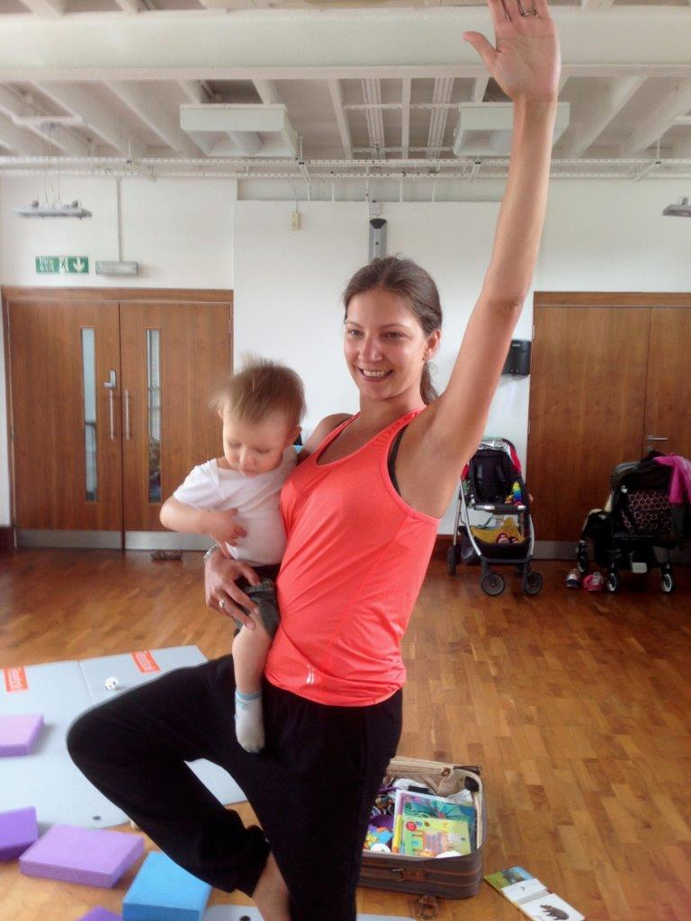 Mum in tree pose with baby