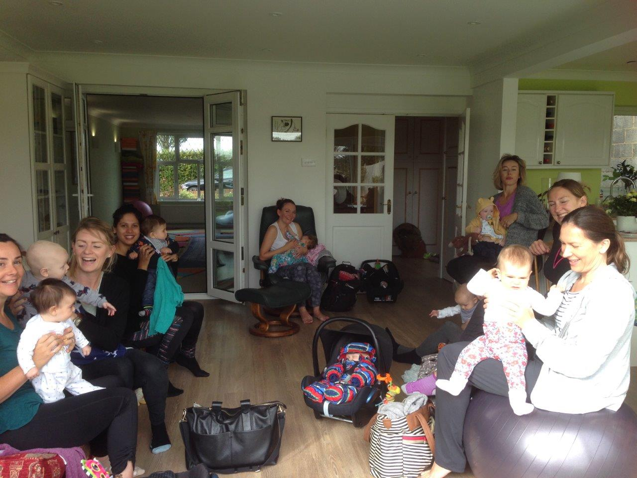 Mums with babies before postnatal yoga class