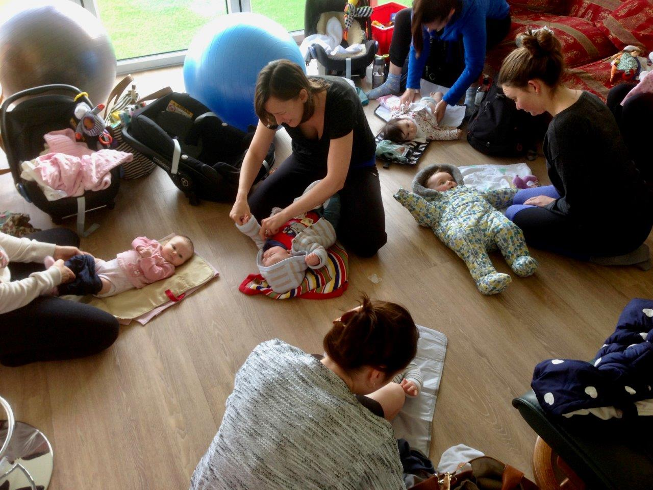 Mums preparing their babies for home after mum & baby yoga class
