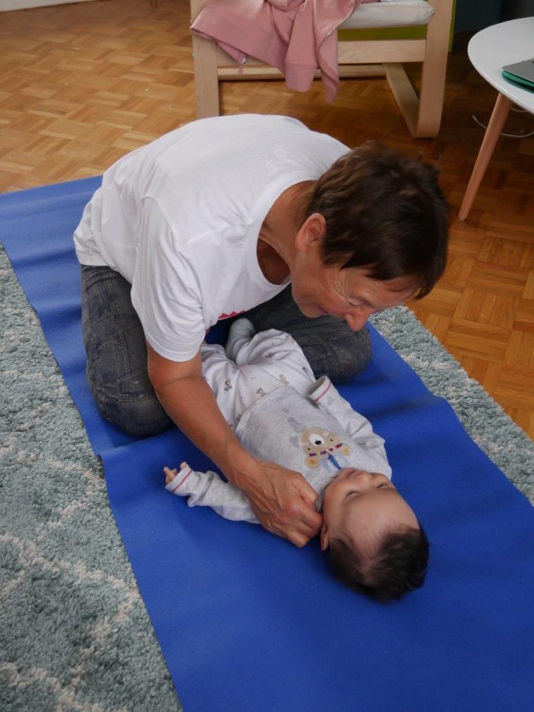 GrannySue on yoga mat with baby