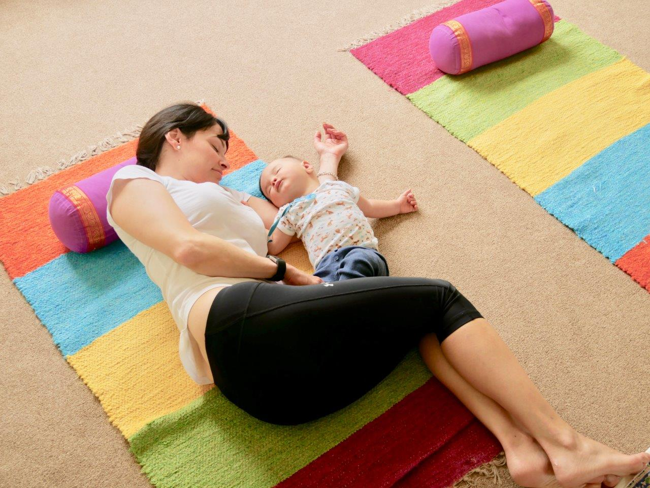 Mum & Baby both relaxing on floor at the end of Mum & Baby yoga class